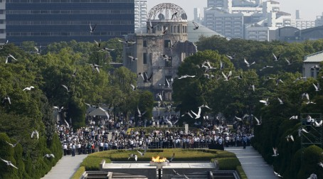 Doves fly over the Peace Memorial Park with the Atomic Bomb Dome in the background, at a ceremony in Hiroshima, western Japan, August 6, 2015, on the 70th anniversary of the atomic bombing of the city. Japan on Thursday marked the 70th anniversary of the attack on Hiroshima, where the U.S. dropped an atomic bomb on August 6, 1945, killing about 140,000 by the end of the year in a city of 350,000 residents. It was the world's first nuclear attack. The Atomic Bomb Dome, or Genbaku Dome, was the only structure left standing in this district of the city and has been preserved as a peace memorial.   REUTERS/Toru Hanai  - RTX1N895